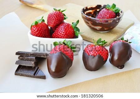 Fresh strawberries covered with dark chocolate. - stock photo