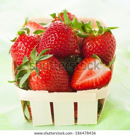 fresh strawberries in a basket. - stock photo