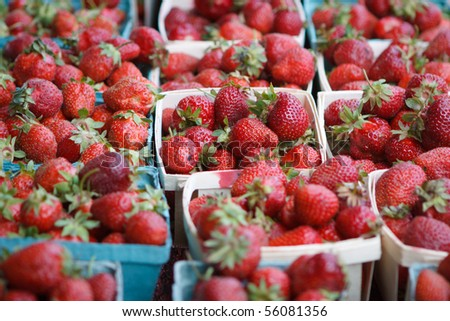 Fresh strawberries in baskets at market - stock photo