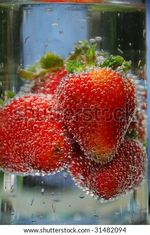 Fresh strawberries in glass - stock photo
