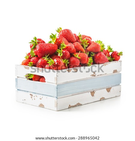 Fresh strawberries in old wooden crate isolated on white background. Healthy eating. Object with clipping path - stock photo