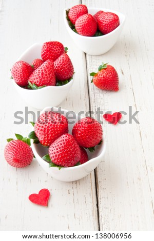 Fresh strawberries in portion bowls. Healthy eating. - stock photo