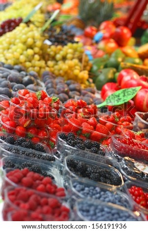 Fresh strawberries on farmers market - stock photo