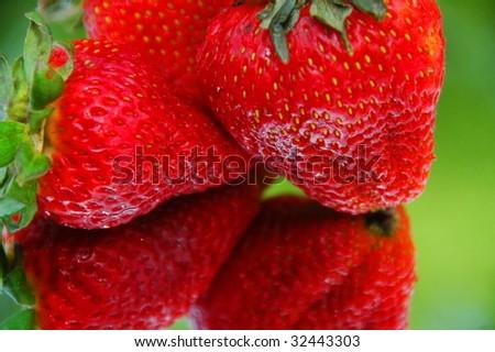 Fresh Strawberries on Mirror - stock photo
