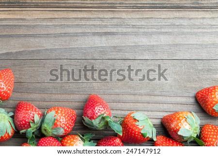 fresh strawberries on old wood - stock photo