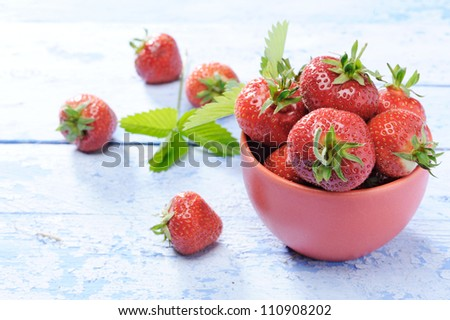 fresh strawberries on old wooden table - stock photo
