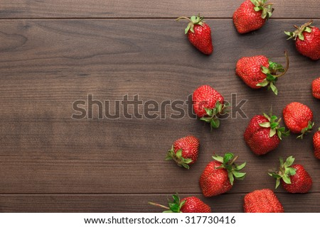 fresh strawberries on the brown wooden table - stock photo