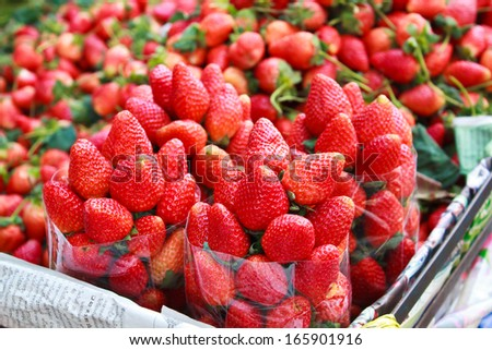 Fresh strawberries on the local market, Thailand. - stock photo