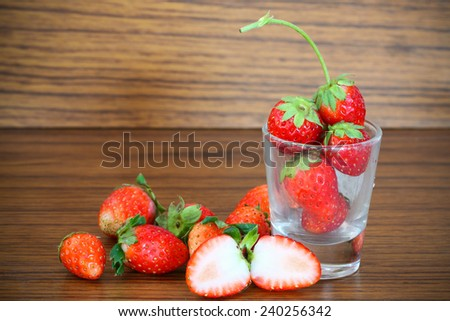 Fresh strawberries, Strawberries in a basket in the garden, Healthy fruit - stock photo