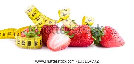 Fresh strawberries with measure tape isolated on white