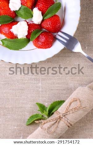 Fresh strawberries with yogurt on the table. Seasonal table sets. - stock photo