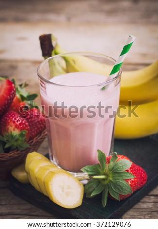 Fresh strawberry and banana smoothie - stock photo