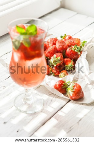 fresh strawberry and glass of ice strawberry cocktail - stock photo