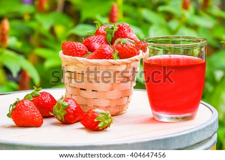 fresh strawberry and juice on wood table