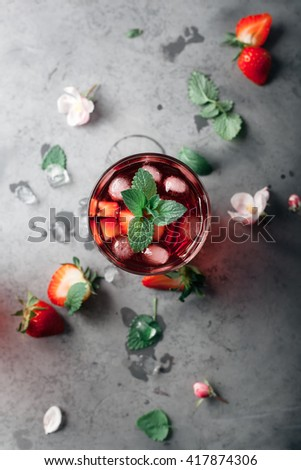 Fresh strawberry and mint drink on grey background. Rustic style. Overview - stock photo
