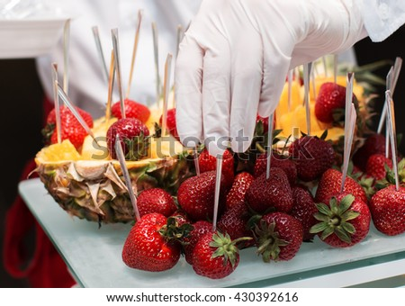 Fresh strawberry and pineapple. Banquet table served with delicious food. Fruit dessert - stock photo