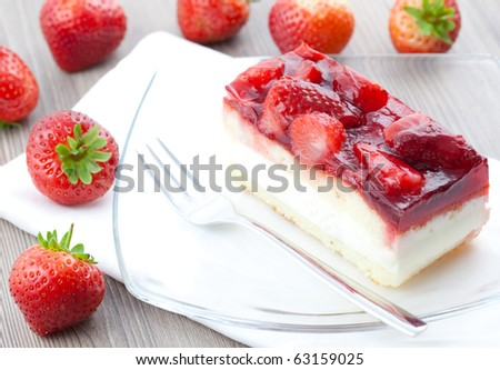 fresh strawberry cake on plate - stock photo