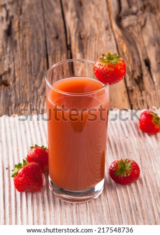 Fresh strawberry drink on wood background, juice drink