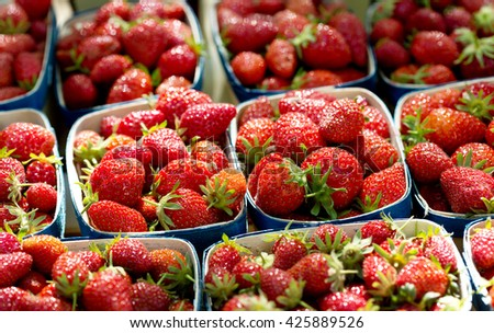 fresh strawberry in the baskets on a market
