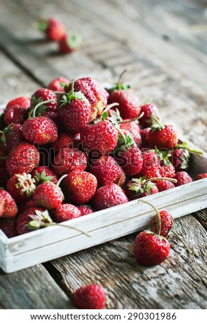Fresh Strawberry in White Box on Wooden Table - stock photo