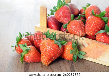 fresh strawberry in wooden crate on table isolated on white - stock photo