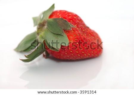 Fresh strawberry isolated on white background  (shallow dof) - stock photo