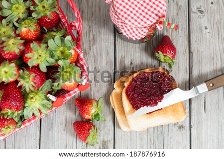 Fresh strawberry jam with toast for breakfast - stock photo
