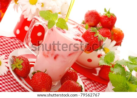 fresh strawberry  milkshake with mint leaves in glass - stock photo