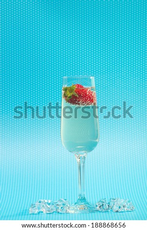 fresh strawberry on a glass filled sparkling wine - stock photo