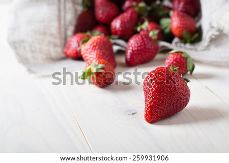 Fresh strawberry on a wooden table - stock photo