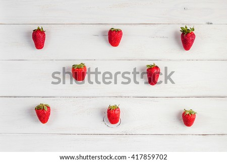 Fresh strawberry on wooden white background. Creative strawberry top view, flat lay - stock photo