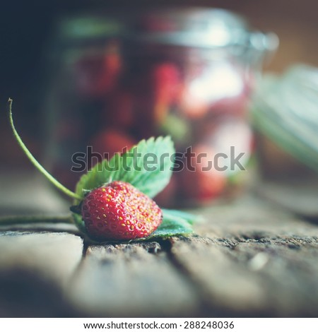 Fresh Strawberry with leaf on Wooden Background. Selective Focus. Toned - stock photo