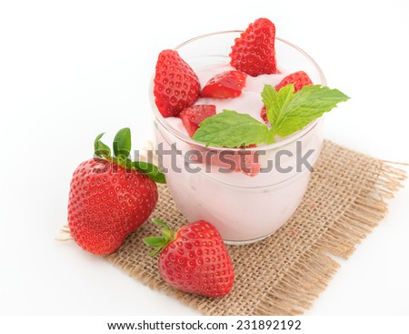 Fresh strawberry with yogurt in a glass isolated on white - stock photo