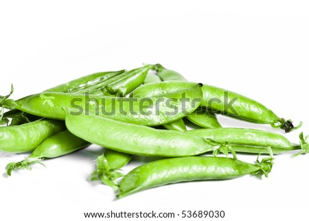 Fresh sugar snap peas isolated on a white background - stock photo