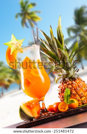 Fresh summer mojito on wood with tropical beach  - stock photo