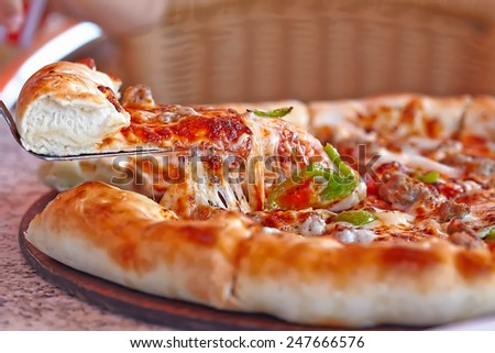 Fresh supreme italian pizza with cheesy board - stock photo