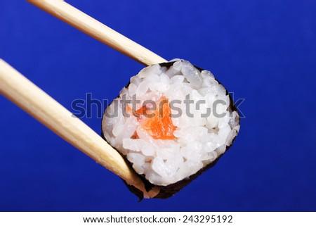 Fresh Sushi on blue background - stock photo