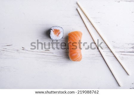 Fresh sushi on white background - stock photo