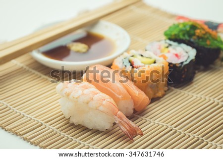 fresh sushi traditional japanese food , vintage - stock photo