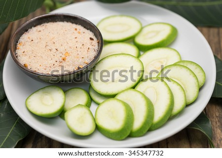 Fresh sweet and sour green sliced mango with chili paste for tropical fruit background with selective focused point - stock photo