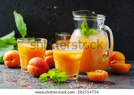 Fresh sweet apricot juice and mint, selective focus - stock photo
