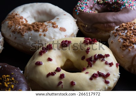 fresh sweet baked color doughnut close up - stock photo