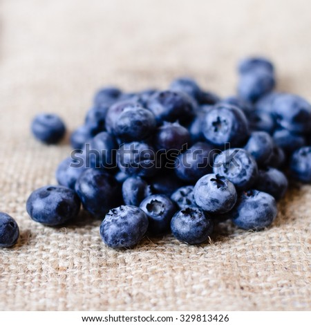 Fresh sweet blueberry fruit. Dessert healthy food. Group of ripe blue juicy organic berries. Raw summer diet. Delicious nature vegetarian ingredient. - stock photo