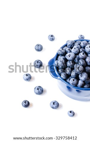 Fresh sweet blueberry fruit in bowl. Dessert healthy food. Group of ripe blue juicy organic berries. Raw summer diet. Delicious nature vegetarian ingredient. Isolated on white background. - stock photo