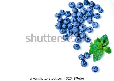 Fresh sweet blueberry fruit in the wooden spoon, juicy blueberry with leaf of mint. Dessert of juicy blueberry healthy food Group of ripe blue blueberry juicy organic berries Delicious juicy blueberry