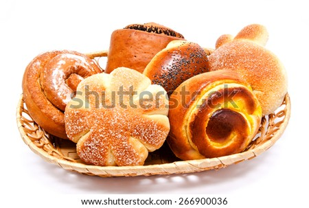 Fresh sweet buns and rolls with poppy and cream in the basket isolated on a white - stock photo