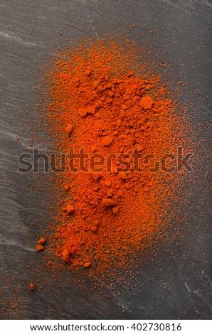 fresh sweet hungarian ground paprika on slate - stock photo