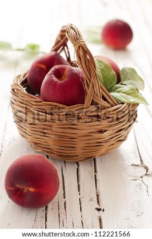 Fresh sweet peach in the basket - stock photo