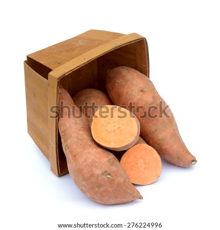 fresh sweet potatoes in wooden bucket on white background - stock photo