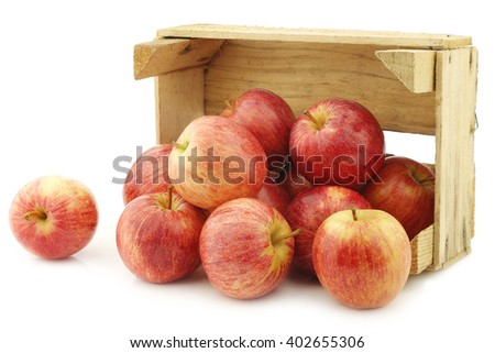 fresh sweet small apples in a wooden crate on a white background - stock photo